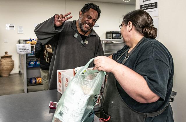 Volunteer bagging goods